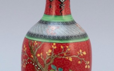 CHINESE FAMILLE ROSE PORCELAIN BALUSTER-FORM VASE Decoration of exotic birds in a floral landscape on a ruby red ground. Four-charac...