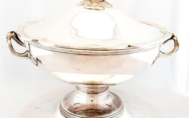 Covered bowl on silver plated metal stand, resting...