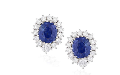 Description A PAIR OF SAPPHIRE AND DIAMOND CLUSTER EARRINGS...