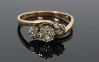 Diamond three stone ring with three old cut diamonds in cross-over claw setting on 9ct gold shank. Estimated total diamond weight approximately 0.65cts. Ring size O½