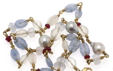 Josephine Bergsøe: A necklace set with numerous fancy-cut sapphires and kalcedones, ruby roundels and cultured pearls, mounted in 18k gold. L. 41 cm.