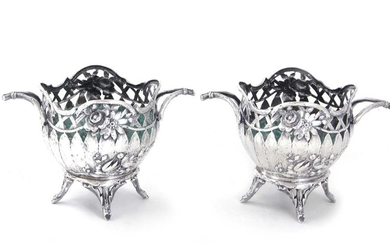 Pair Continental silver cachepots