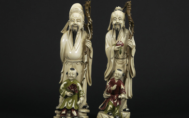 Pair of antique Chinese sculptures in partly polychromed...