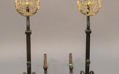 "Pair of iron andirons with large brass tops, ht. 30""."