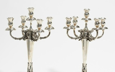 Pair of splendid silver candelabra with dolphin decor
