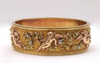 "Rigid bracelet in 18K yellow, pink and white gold decorated with a ""Frieze of angels and flowers"". Period: Napoleon III. Dim. inside: +/-5.5x4.5cm. Total weight: +/- 57.85gr."