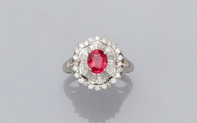 Ring in white gold, 750 MM, centered on an oval ruby weighing 1.40 carat surrounded by baguette-cut and trapezium-cut diamonds in a row of brilliant-cut diamonds, total about 1 carat, 17 x 15 mm, size: 55, weight: 4.55gr. rough.