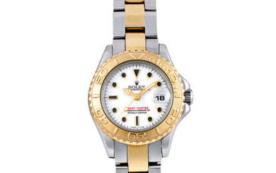 Rolex. A Lady's Yellow Gold and Stainless Steel Wristwatch with Bracelet and Date
