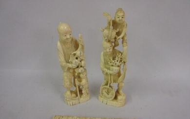 Two 19th Century Chinese carved ivory figures of tradesmen, ...