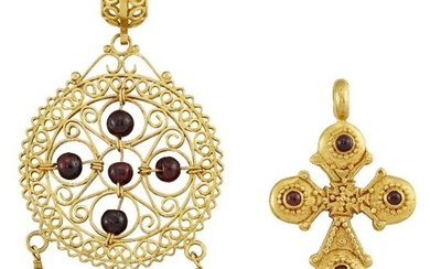 Two garnet-set pendants, the first modelled as...