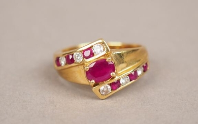 Yellow gold ring, decorated in its centre with a ruby and two lines of small diamonds and alternating rubies.