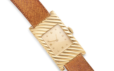 a gold leather strap manual curved wristwatch