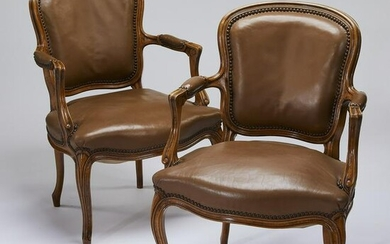 (2) Early 20th c. walnut fauteuils in leather