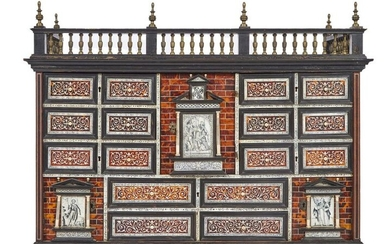 238-Beautiful cabinet in veneer, ebony and blackened wood veneer of tortoiseshell, bone and ivory with religious scenes flanked by small columns and architectural motifs, it opens to a central door that conceals three drawers and ten drawers and two...