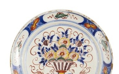 38-Delft: a polychrome earthenware plate with a flowered basin. Wing...