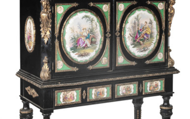 A pair of German 19th century porcelain and gilt bronze mounted ebonised cabinets on stands