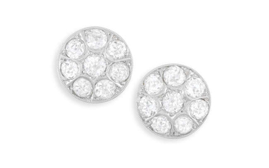 Description A PAIR OF DIAMOND EARRINGS Each round-shaped plaque...