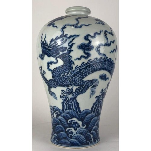 A CHINESE BLUE AND WHITE BALUSTER VASE Decorated with a four...