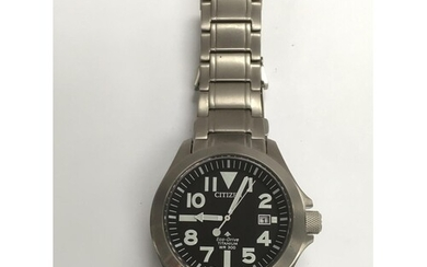A Citizen eco pro master titanium watch with black face and ...