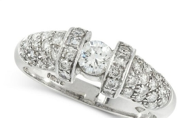 A DIAMOND DRESS RING in platinum, set with a round cut