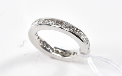 A DIAMOND ETERNITY RING-The full circle ring set with princess cut diamonds totalling 2.18cts, in 18ct white gold, ring size J.