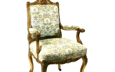 A French gilded armed chair with upholstered seat and back.