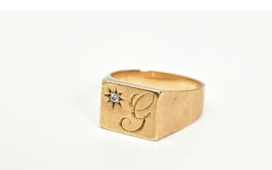 A GENTLEMANS 9CT GOLD SIGNET RING, designed with a square wi...