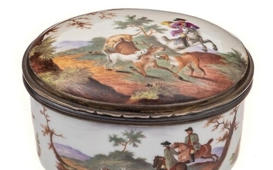 A German porcelain oval snuff box: the cover, sides and base...