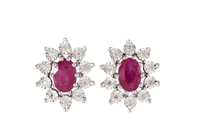 A PAIR OF DIAMOND AND RUBY CLUSTER EARRINGS, mounted in whit...