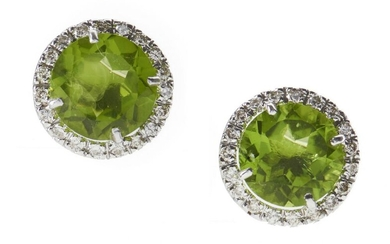 A PAIR OF PERIDOT AND DIAMOND EARRINGS - Each earring comprising a round cut peridot of 6cts, bordered by round brilliant cut diamon...