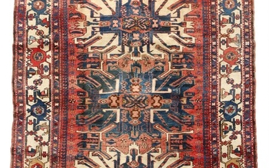 A Persian Karadjeh rug, classic design with three hooked medallions on red base. 20th century. 212×160 cm.