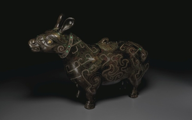 A RARE LARGE GOLD AND SILVER-INLAID BRONZE TAPIR-FORM VESSEL, XIZUN, YUAN-MING DYNASTY (1279-1644)