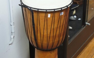 A TRIBAL WOODEN DRUM