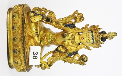 A Tibetan gilt bronze and hand painted figure of a seated Tara, H. 20.5cm.