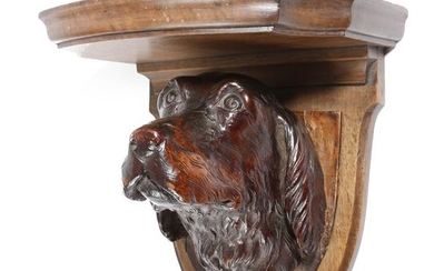 A VICTORIAN CARVED WOOD SPANIEL WALL BRACKET BY...