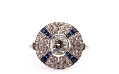 A diamond and sapphire target style circular cluster ring, i...