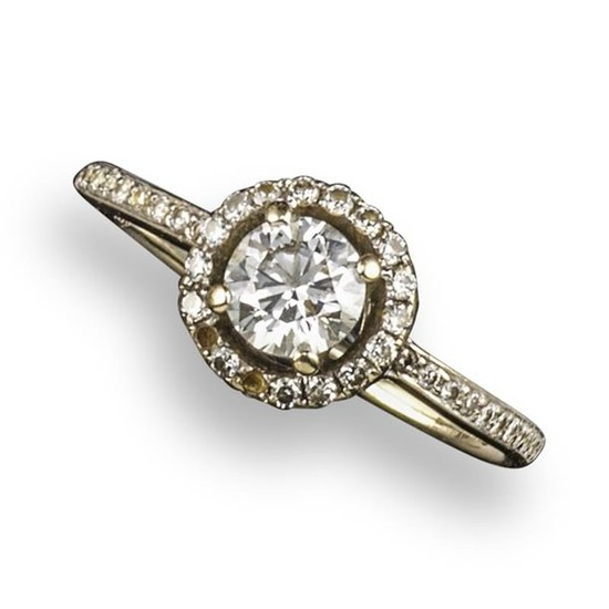 A diamond cluster ring, the round brilliant-cut diamond...