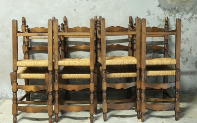 A group of eight walnut rustic chairs