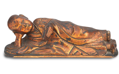 A lacquered wood reclining Buddha