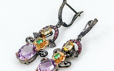 A pair of ear pendants each set with numerous oval and circular-cut amethysts, citrines, onyx and garnets, mounted in rhodium and gold plated silver.