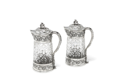 A pair of large French silver-mounted claret jugs
