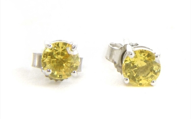 A pair of white gold single stone yellow sapphire stud earrings