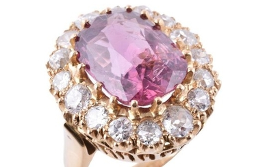 A pink spinel and diamond cluster ring