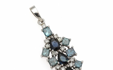 A sapphire and diamond pendant set with three pear-shaped sapphires encircled by numerous diamonds, mounted in 14k white gold.
