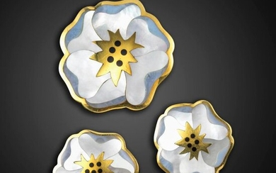 A suite of gem-set gold pansy jewellery by Tiffany & Co., c.1980, comprising a brooch and a pair of earrings, the petals inlaid with mother-of-pearl and black jade in gold, all signed, earrings with post and clip fittings, 3.5cm wide, brooch 5cm wide