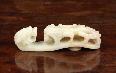 An Antique Chinese White Jade Belt Hook with zoomorphic carving, 2½'' (6.5 cm) in length.