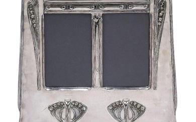 An Art Nouveau silvered pewter double photograph frame, probably German...