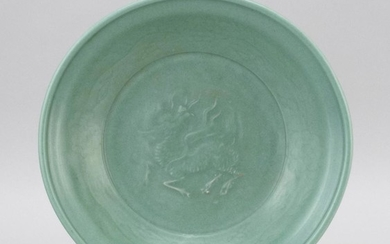 """CHINESE CELADON STONEWARE CHARGER With an unusual relief qilin design surrounded by a floral border. Diameter 12""""."""