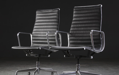 Charles Eames. Two office chairs, Aluminium Group, black leather (2)