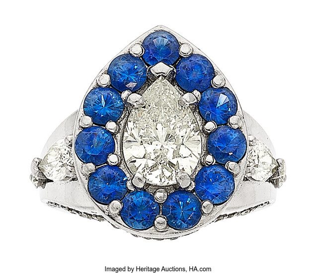 Diamond, Sapphire, Platinum Ring The ring features a pear-shaped...